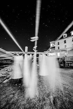 Clothes line in the wind, Star island. by Ken Kartes