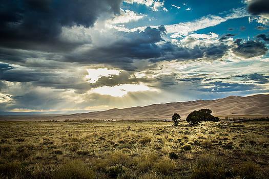 Cloud Break Over Sand Dunes by Laura Roberts