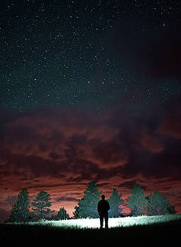 Clouds and a starry sky by Bill Gabbert