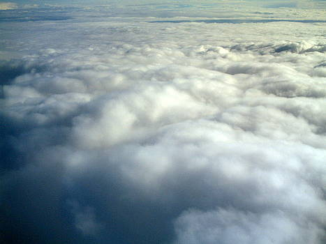 Clouds from the plane IV by Emiliano Giardini