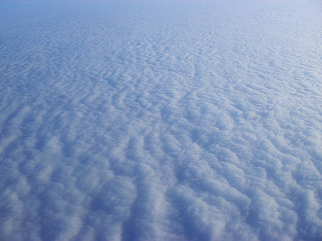 Clouds from the plane IX by Emiliano Giardini