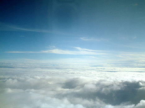 Clouds from the plane V by Emiliano Giardini