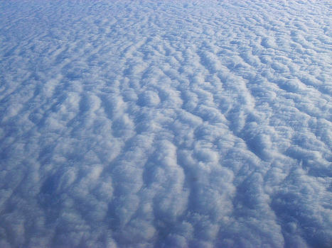Clouds from the plane XII by Emiliano Giardini