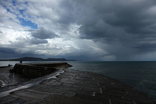 Clouds Over Lyme Bay by Mike Finding