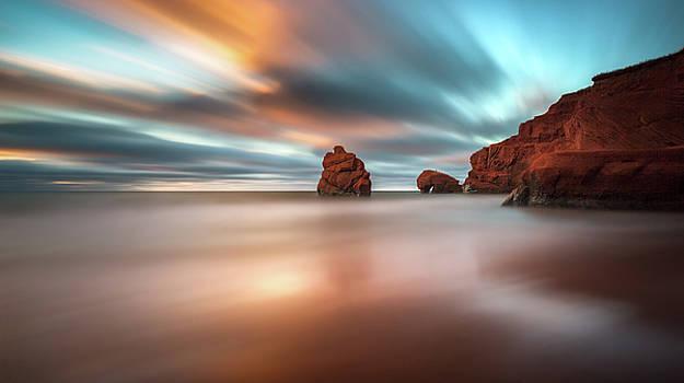Cloudy sunrise on the beach by Yves Keroack