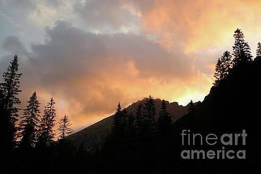Cloudy sunset over the Tatra mountains by John Janicki