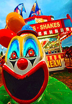 Clown head, county fair. by Bill Jonscher