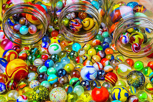 Clse Up Jars Of Marbles by Garry Gay