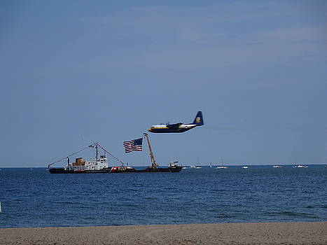 Coast Guard Boat meets Plane by Red Cross