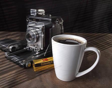 Coffe cup and Camera by Gary De Capua