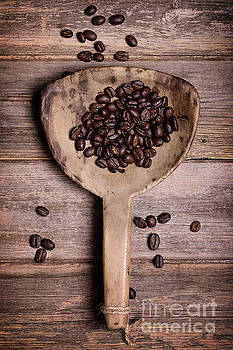 Coffee beans in antique scoop. by Jane Rix