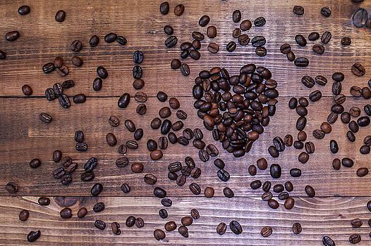 Coffee beans in heart shape by Miro Vrlik