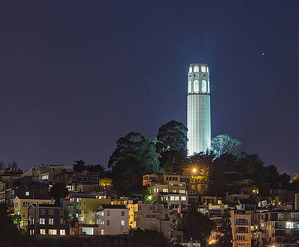 Coit Tower at night from pier by Mark Chandler