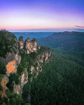Cold morning but warm sunrise colors in the sky at Three Sisters by Daniela Constantinescu