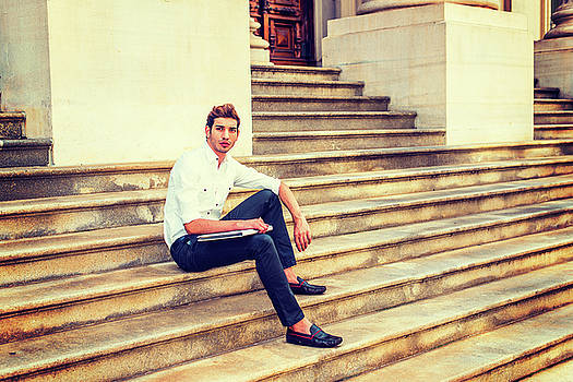 Alexander Image - College student sitting on stairs, relaxing outside