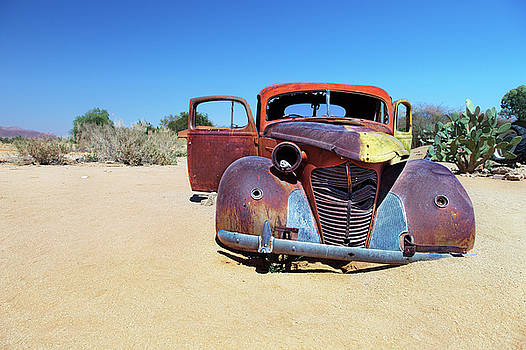 Colorful car wrek in Solitaire Namibia by Martin Wackenhut