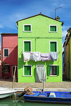 Colorful houses green and red in Burano Venice Italy by Matthias Hauser