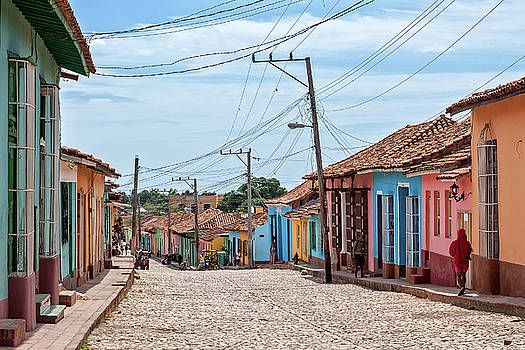 Colorful houses on a cobblestone street in Trinidad. by Daniela Constantinescu