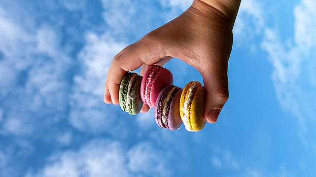 Colorfull Macaroons On Blue Sky Background by Tamara Sushko