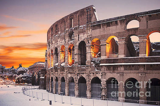 Colosseum covered in snow at sunset by Stefano Senise