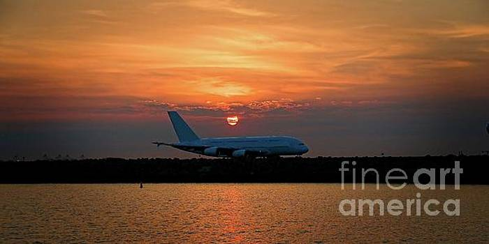 Commercial Jet Aircraft at Sunset by Geoff Childs