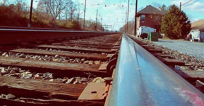 Commuter train tracks, Downingtown, Pa. by Gerald Salamone