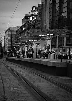 Commuters at tram station by Beverly Cash