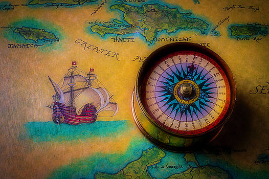 Compass And Ship On Old Map by Garry Gay