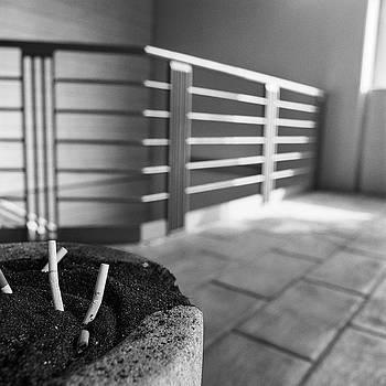 Concrete Ashtray Close Up Cigarette Butts  by YoPedro
