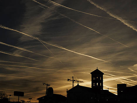 Contrails at Sunrise by Kelly E Schultz