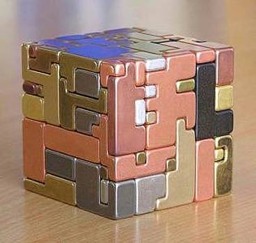 Conundrum III- Puzzling Cube  by Gare Maxton