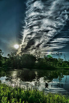 Cool looking cloud in the morning sun by Sven Brogren