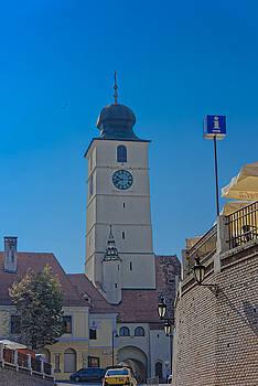 Council Tower Sibiu Romania tower on blue sky by Adrian Bud