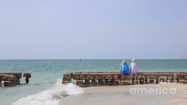 Edward Fielding - Couple sitting on an old jetty Siesta Key Beach Florida