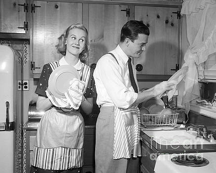 Debrocke ClassicStock - Couple Washing Dishes And Smiling