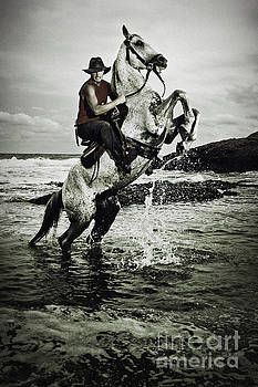 Cowboy on the rear up horse in the river by Dimitar Hristov