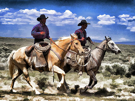 Cowboys on Horseback riding the range by Nadja Rider