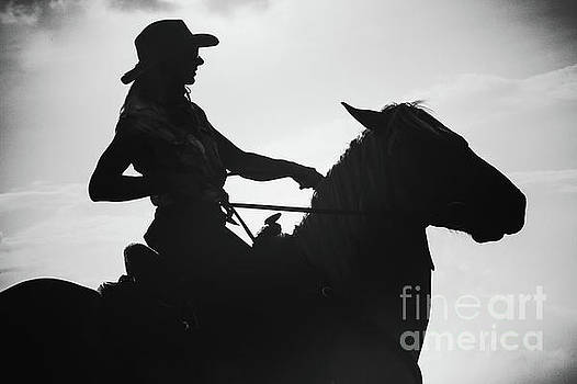 Dimitar Hristov - Cowgirl and horse silhouette
