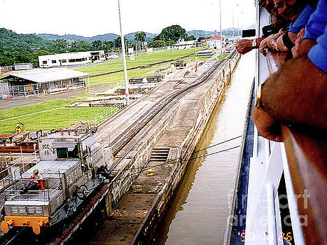 Cruise Ship Pulled Into Panama Canal Lock by Merton Allen