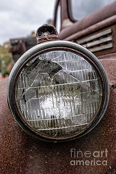 Cracked Headlight on an old truck by Edward Fielding