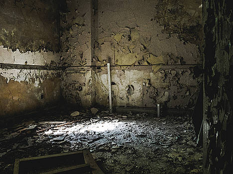 Cracked walls in abandoned building by Dylan Murphy
