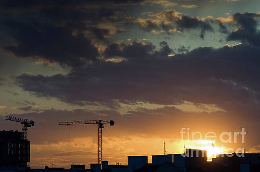 Cranes and rooftops by John Janicki