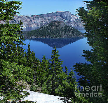 Crater Lake through the trees by Gregory Dyer