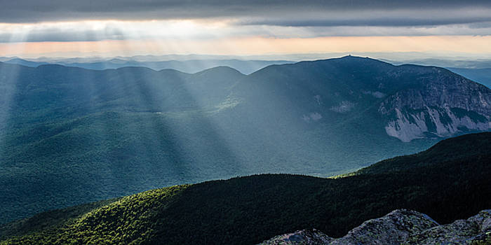 Crepuscular rays shining onto Franconia Ridge, New Hampshire by Matthew MacPherson