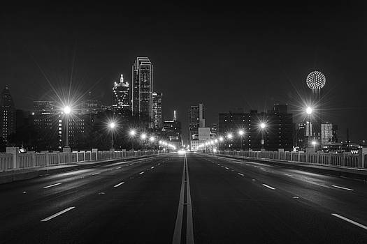 Crossing The Bridge to DownTown Dallas at Night in Black and White by Todd Aaron