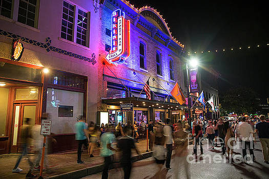 Herronstock Prints - Crowds walk up and down past the bright neon lights of Austin fa