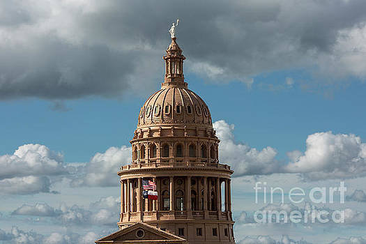 Herronstock Prints - Crowning the dome of the Texas State Capitol stands the Goddess of Liberty statue with Texas and USA flags flying below