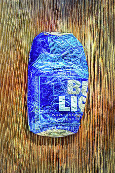 Crushed Blue Beer Can on Plywood by YoPedro