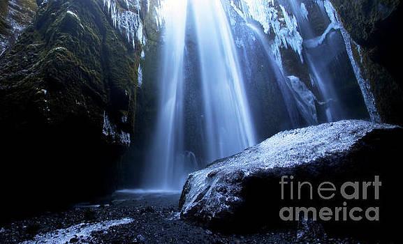 Crystal Cavern - Iceland's Gljufrabui Falls in Winter by Matt Tilghman