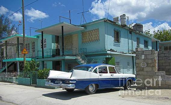 John Malone - Cuban Home with Car in Driveway